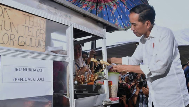 President Jokowi is seen Buying and Eating Fried Cilok