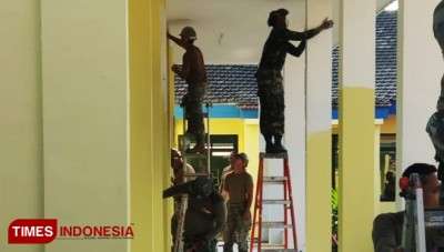 The US Navy Conducting Social Service and Help to Renovate a School Building in Gresik