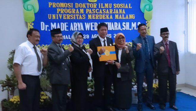 The Head of Disparbud Malang Gets Doctoral Degree from Unmer Malang