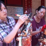 The Process of Cleaning the God and Goddess Statues at En Ang Kiong Temple Malang